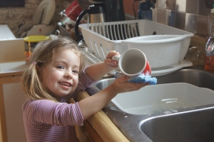 """I really, really love doing the dishes Mommy!"""